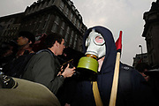 Black Watch protester wearing a gas mask at the Trades Union Congress (TUC), called 'The March for the Alternative,' in central London. Tens of thousands of Britons protested against the coalition government's austerity measures on Saturday in the biggest demonstration in the capital since 2003.