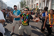 The 49th Notting Hill Carnival in West London. A celebration of West Indian / Caribbean culture and Europe's largest street party, festival and parade. Revellers come in their hundreds of thousands to have fun, dance, drink and let go in the brilliant atmosphere. Revellers make their way.