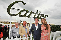 Left to right, TERRY O'NEILL, ANDREW NEIL, PIERS MORGAN and CELIA WALDEN at the 25th annual Cartier International Polo held at Guards Polo Club, Great Windsor Park, Berkshire on 26th July 2009.