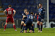 Oli Shaw of Ross County celebrates with team his  2nd goal during the Scottish Premiership match between Ross County FC and Aberdeen FC at the Global Energy Stadium, Dingwall, Scotland on 16 January 2021.