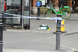 © Licensed to London News Pictures. 09/07/2019. London, UK. A medical kit is seen on Seven Sisters Road in Finsbury Park, north London following a stabbing at about 9.45pm on Monday 8 July 2019. Police officers found a 30 years old man suffering a knife wound and a second man, believed to be in his late twenties, was discovered with a gunshot injury in the nearby Blackstock Road. According to the police, the stab victim is in a stable condition. Photo credit: Dinendra Haria/LNP