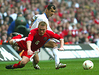 Photo: Scott Heavey<br />Wales V Azerbaijan. 29/03/03.<br />Mahmud Gurbanov brings down Mark Paembridge of Wales during this afternoons Euro 2004 Group 9 qualifying match at the Millenium stadium in Cardiff.