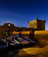 ESSAOUIRA, MOROCCO - CIRCA MAY 2018:  Blue hour over the port of Essaouria and the famous Castelo Real of Mogador.