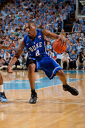 CHAPEL HILL, NC - MARCH 05: Nolan Smith #2 of the Duke Blue Devils dribbles while playing the North Carolina Tar Heels on March 05, 2011 at the Dean E. Smith Center in Chapel Hill, North Carolina. North Carolina won 67-81. (Photo by Peyton Williams/UNC/Getty Images) *** Local Caption *** Nolan Smith
