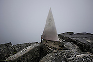 The aluminum plack marking the summit of Mt. Fansipan, the highest mountain in Indochina, Lao Cai Province, Vietnam, Southeast Asia