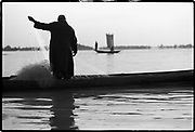 In the great river of life there are large and small fish.   Ghanaian proverb<br /> <br /> A fisherman fishes in the Niger River, a prominent river in West Africa. Bamako, Mali  1992