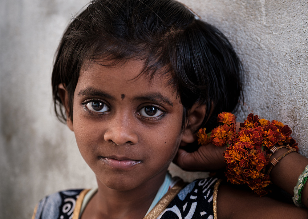 VARANASI, INDIA - CIRCA NOVEMBER 2018: Portrait of girl from a fishing village close to Varanasi. Varanasi is the spiritual capital of India, the holiest of the seven sacred cities and with that many rituals and offerings are performed daily by priests and hindus.