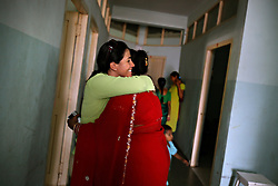 American Jessica Ordenes, 40, gets reassurance from Rubina Mondal, 30, a surrogate who recently gave birth for an American-Korean couple in Anand, India on April 12, 2007. Dr. Nayna Patel, the hospital director, currently has more than 25 women who have been implanted with embryos at her clinic. A few have already gone through the process once and are eager for a second go-round. While Patel claims many of the women do this for altruistic reasons, she acknowledges that money was the primary reason these women had queued up to be surrogates; without it, the list would be short, if not nonexistent. Payment usually ranges from about $2,800 to $5,600, a fortune in a country where annual per capita income hovers around $500.