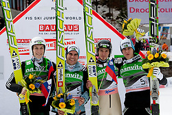 Third placed team of Slovenia: Jurij Tepes, Jernej Damjan, Robert Kranjec and Peter Prevc celebrate at flower ceremony during Flying Hill Team at 3rd day of FIS Ski Jumping World Cup Finals Planica 2011, on March 19, 2011, Planica, Slovenia. (Photo by Vid Ponikvar / Sportida)