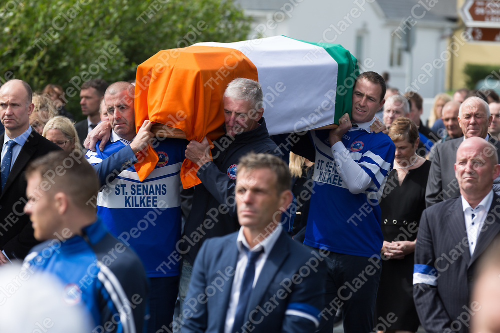 David Russell, Darragh Kelly and Michéal Keane carrying the coffin of Michael O'Shea