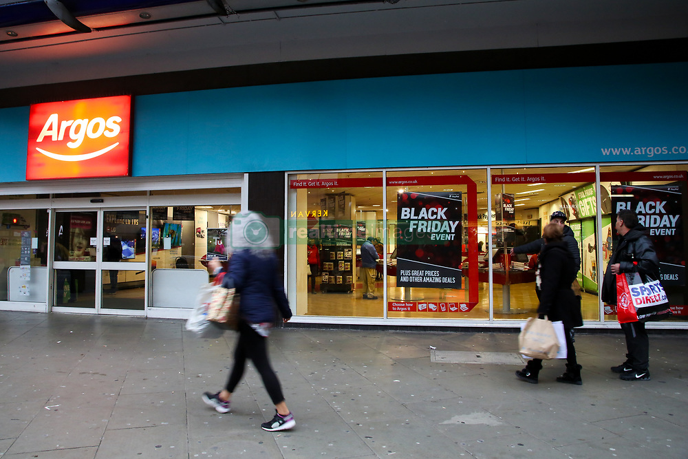 November 22, 2018 - London, United Kingdom - Shoppers are seen standing next to the Argos store in London as they prepare for Black Friday event with huge savings. (Credit Image: © Dinendra Haria/SOPA Images via ZUMA Wire)