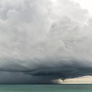 Cruise ship approaching storm in the caribbean. Riviera Maya. Quintana Roo, Mexico.