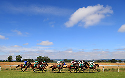 Go Annie ridden by Brett Doyle (right) leads the field round the back bend during The Get Daily Tips At Racinguk.com Selling Stakes at Thirsk Racecourse, Thirsk.