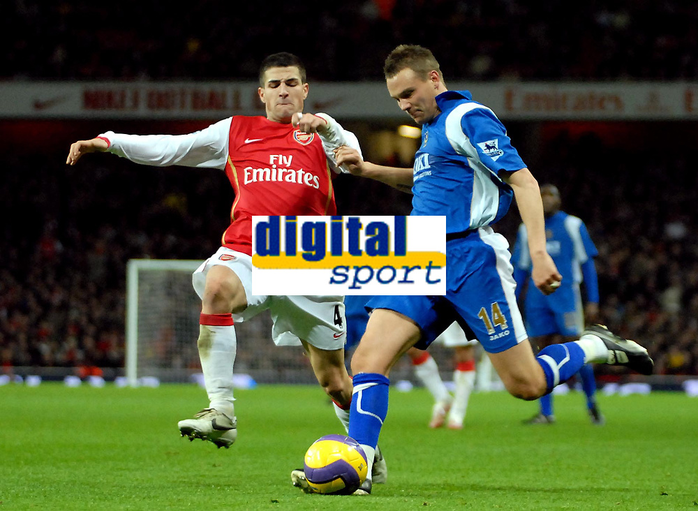 Photo: Ed Godden.<br />Arsenal v Portsmouth. The Barclays Premiership. 16/12/2006. Portsmouth's Matthew Taylor crosses the ball ahead of Cesc Fabregas (L).