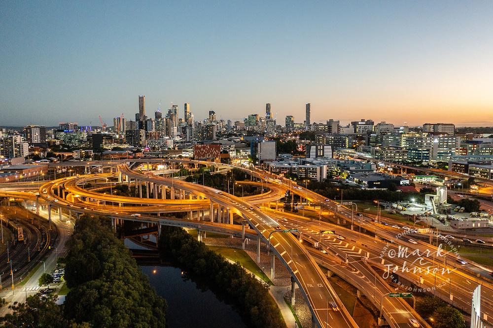 Aerial view of the Inner City Bypass & Airport Link highway interchange with Brisbane City in the distance, Bowen Hills, Brisbane, Queensland, Australia