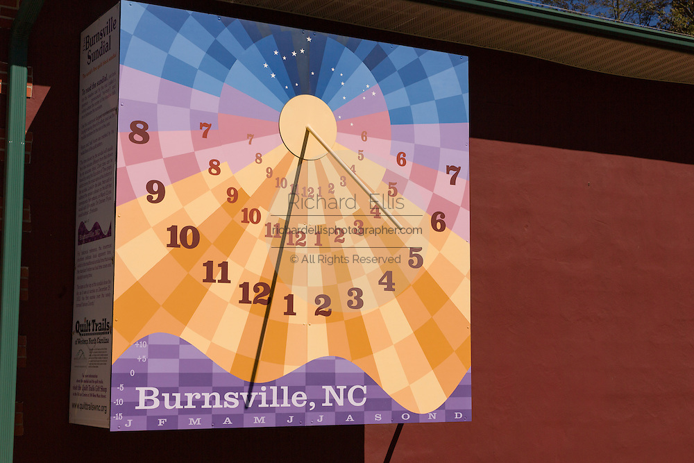 Burnsville Quilt Block Sundial on the Yancey Times Journal building in Burnsville, North Carolina. The sundial honors the quilt trails and is the largest vertical sundial in North Carolina.