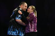 Anastasia Dobromyslova congratulates Ryan Joyce during the World Championship Darts 2018 at Alexandra Palace, London, United Kingdom on 17 December 2018.