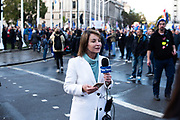 International media covers the story the events unfolding during the People's Vote March at Parliament Square, London