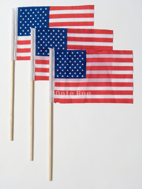 studio still life with 3 small American flags