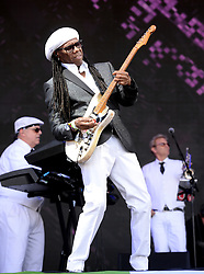 Nile Rodgers and Chic performing on the Pyramid Stage at Glastonbury Festival, at Worthy Farm in Somerset.