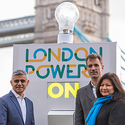 © Licensed to London News Pictures. 13/01/2020. LONDON, UK.  London, UK.  13 January 2020.  Sadiq Khan, Mayor of London (L), Shirley Rodrigues, Deputy Mayor for Environment and Energy (R), and Stuart Jackson, CEO of Octopus Energy (C), at the switch-on of a giant lightbulb in front of Tower Bridge to mark the launch of a brand new fair-priced, green energy company, available exclusively to Londoners to cut fuel bills and help make the capital a zero carbon city.    Photo credit: Stephen Chung/LNP