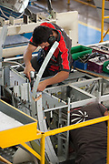 An employee works on the assembly line of the C-27J Spartan aircraft at the Alenia Aeronautica plant at Capodichino, in Naples, Italy, on Monday, Sept. 6, 2010.