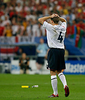 Photo: Glyn Thomas.<br /> England v Portugal. Quarter Finals, FIFA World Cup 2006. 01/07/2006.<br /> England's Steven Gerrard is dejected after missing his penalty.