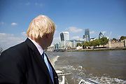 London, UK. Monday 8th September 2014. London Mayor Boris Johnson travelling down the Thames on the Silver Darling, after a visit to Royal Greenwich Tall Ships Festival which is organized by RB Greenwich. The Festival is included as a highlight of Totally Thames, the new month-long promotion of river and riverside events delivered by Thames Festival Trust.