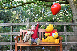 EDITORIAL USE ONLY<br /> Ed Clayton, three, sits on a bench, known as a ÔThotful SpotÕ, that talks to you when you sit on it, at '100 Acre Woods' in Ashdown Forest, to celebrate the 90th anniversary of the publication of AA Milne's first collection of stories about Winnie-the-Pooh this Friday.