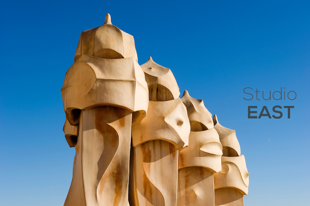 BARCELONA, SPAIN - DECEMBER 30: The chimneys of Art Nouveau building La Perdrera look like knights with helmets in Barcelona, Spain, on December 30, 2011. Casa Mila, better known as La Pedrera (meaning the 'The Quarry'), is a building designed by architect Antoni Gaudi and completed in 1912. (Photo by Lucas Schifres/Getty Images)