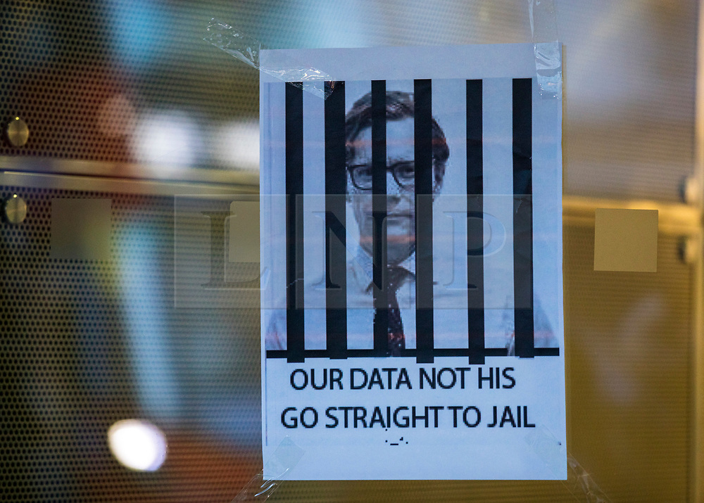 © Licensed to London News Pictures. 20/03/2018. London, UK. A poster which depicts Cambridge Analytica CEO Alexander Nix behind bars attached to the window of the office building which houses the company's offices in central London. Cambridge Analytica has been implicated in an investigation in to the misuse of Facebook user data to influence the outcome of elections. Photo credit: Rob Pinney/LNP