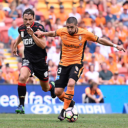 BRISBANE, AUSTRALIA - DECEMBER 11: Dimitri Petratos of the Roar dribbles the ball under pressure from James Holland of Adelaide United during the round 10 Hyundai A-League match between the Brisbane Roar and Adelaide United at Suncorp Stadium on December 11, 2016 in Brisbane, Australia. (Photo by Patrick Kearney/Brisbane Roar)