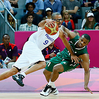 06 August 2012: France Tony Parker is fouled by Nigeria Chamberlain Oguchi during 79-73 Team France victory over Team Nigeria, during the men's basketball preliminary, at the Basketball Arena, in London, Great Britain.