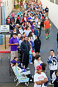 """Oct. 24, 2009 - SCOTTSDALE, AZ: People line up at Scottsdale Healthcare's Community Health Services clinic to get the H1N1 vaccine Saturday morning. The first publicly administered H1N1 (""""swine flu"""") vaccinations were given in the Phoenix area Saturday. About 52,000 doses of the vaccine, in both injection and nasal spray form, were available on a first come first served basis, but only to those in so called """"high risk"""" groups: pregnant women, children 6 months to 4 years old, children 5 years to 18 years with underlying health concerns and direct caregivers of infants less than 6 months old. More than 700 people lined up at Scottsdale Health Care, which had 500 doses of the vaccine to administer.     Photo by Jack Kurtz"""