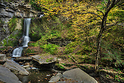 Finger Lakes, NY<br />   Maybe an understanding of chaos let me make some kind of connection in this scene.  Misery loves company.  This jumble of boulders obstructing the flow, the wild ground cover, the tangle of branches and foliage overwhelmed me at first.  The  spill of water down the cliff was the only constant making sense of this place.  Everything needs an anchor.<br /> I was southbound, but my journey wandered into New York's wine country before dropping into Pennsylvania and West Virginia.  A day of more clouds than sun is generally good for waterfalls, and I ended up at this one, inelegantly named Cowshed Falls.  This early in autumn, a lot of green was still evident, in stages of yellowing that illuminate in lime.  The beech tree was already yellowed, and ever so often a brief waft of sunlight caught the leaves.  <br /> <br /> This image took a lot of work from my capture.  It is one image rendered in HDR, and then I used several luminance masks to accent areas of brightness and darkness in the scene due to the flat appearance of the RAW file.