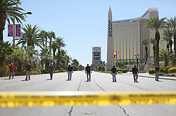 Oct 3, 2017 - Las Vegas, Nevada, U.S. - FBI sweep the area close to a makeshift memorial inside the perimeter of a police barricade on the Las Vegas Strip. A mass shooting occurred late Sunday evening nearby at a music festival. (Credit Image: © Ronda Churchill via ZUMA Wire)