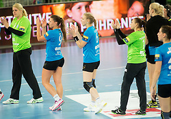 Misa Marincek #16 of RK Krim Mercator, Melanie Bak #9 of Krim Mercator, Ekaterina Ceckova #6 of RK Krim Mercator, Aleksandra Petrukhina #1 of RK Krim Mercator look dejected after the handball match between RK Krim Mercator (SLO) and Dinamo - Sinara (RUS) in 4th Round of Women's EHF Champions League 2014/15, on November 9, 2014 in Arena Stozice, Ljubljana, Slovenia. Photo by Vid Ponikvar / Sportida