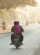 Comuter traffic early in the morning along the streets of Mandalay, Myanmar