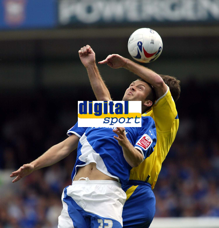 Fotball<br /> Foto: SBI/Digitalsport<br /> NORWAY ONLY<br /> <br /> Ipswich Town v Cardiff City<br /> Coca Cola Championship.<br /> 06/08/2005.<br /> <br /> Ian Westlake is of Ipswich is held down by Chris Barker of Cardiff