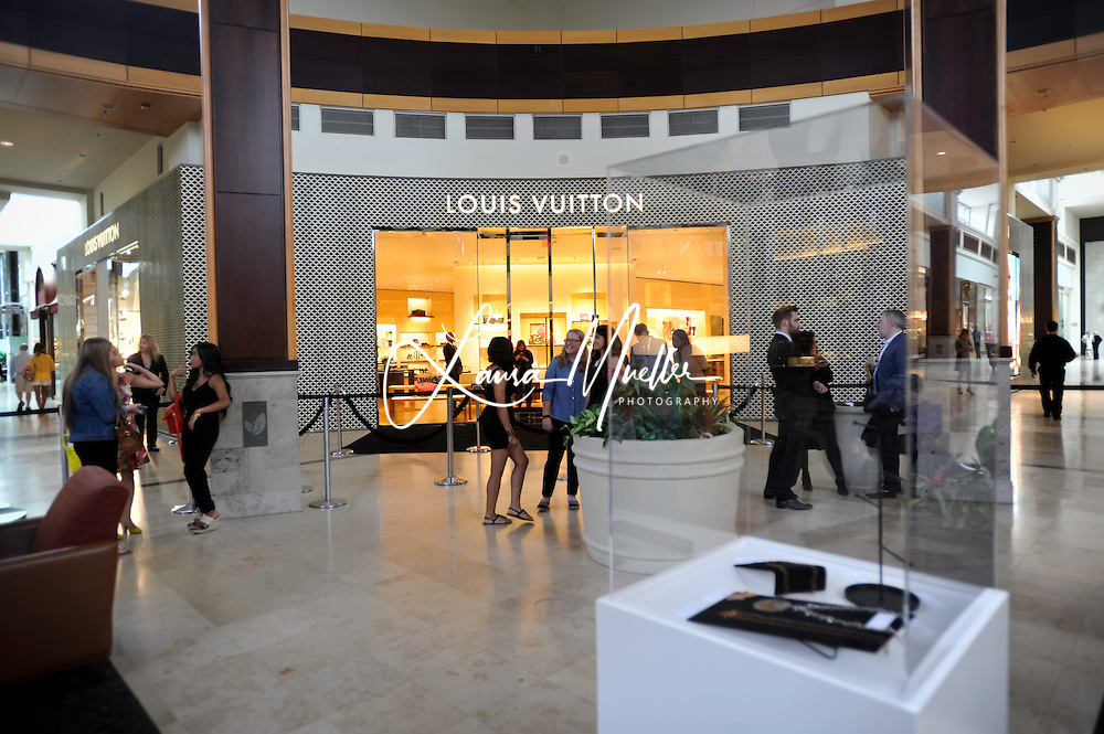 20150602 Louis Vuitton Charlotte hosted an event in partnership with the The Bechtler Museum of Modern Art at SouthPark Mall June 2nd. The reception, held in celebration of the store's recent remodel and expansion, featured and exhibition of student designed jewelry, jazz, shopping, champagne and hors d'Oeuvres.<br /> © Laura Mueller<br /> www.lauramuellerphotography.com