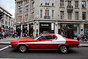 The famous car used in the hit American movie and tv show Starsky and Hutch. This red car with it's distinctive white stripe was a Ford Gran Torino from between the years 1794 and 1976 during which time the car remained the same. Seen here on Regent Street in London