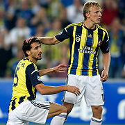 Fenerbahce's Dirk Kuyt (R) and Mehmet Topal during their UEFA Champions League Play-Offs, 2nd leg soccer match Fenerbahce between Spartak Moscow at Sukru Saracaoglu stadium in Istanbul Turkey on Wednesday 29 August 2012. Photo by TURKPIX