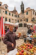 Man showing his apples at the Farmers Market, Dubrovnik, Dalmatian Coast, Croatia