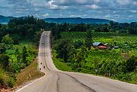 A long, straight road, Uganda.