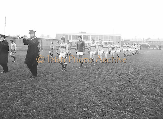 The Guinness team line out onto the pitch at the start of the Guinness v Garda Gaelic Football Club Tournament Final on the 14th October 1979.