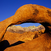Mt. Whitney, highest in the contiguous 48 states, is framed by a sandstone arch in the Alabama Hills.