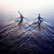 two people canooning out to sea.