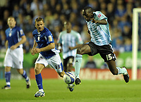 Toumani Diagouraga of Peterborough United streaks past Richie Wellens of Leicester City<br /> Leicester City vs Peterborough United<br /> Coca Cola Championship, Walkers Stadium, Leicester, UK<br /> 15/09/2009. Credit Colorsport/Dan Rowley<br /> Football