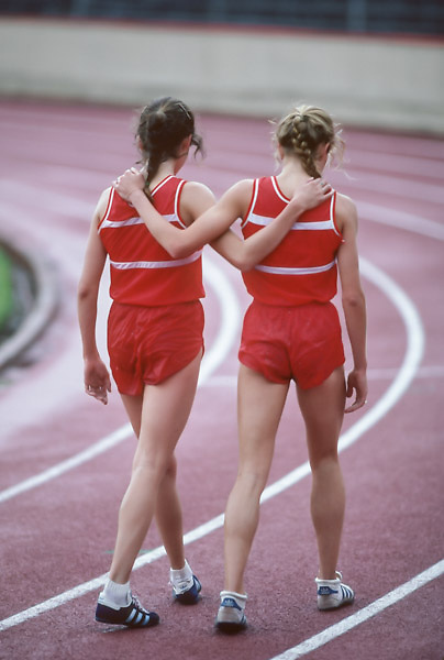 COLLEGE TRACK:  Ceci Hopp (R)) and Kim Schnurpfeil (L) after a race on the track in Stanford Stadium at Stanford University in Palo Alto, California in April 1982.  Photograph by David Madison (www.davidmadison.com)