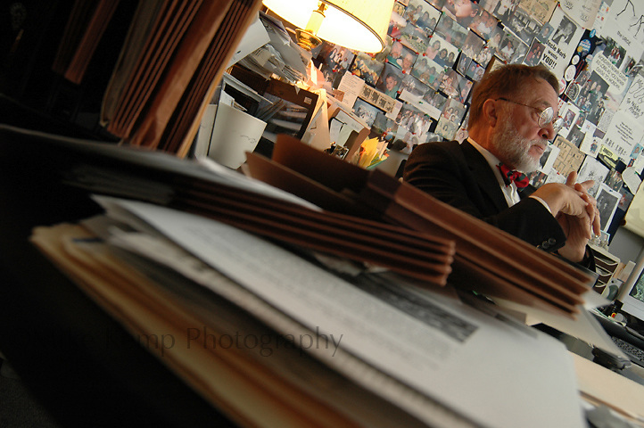 Admist stacks of papers in his office, Norb Schedler reflects on his past accomplishments as the founder of the Honors College at the University of Central Arkansas.